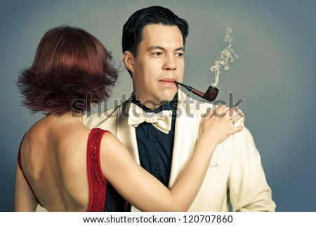 Couple of professional artist in retro style posing in costumes at studio. - stock photo