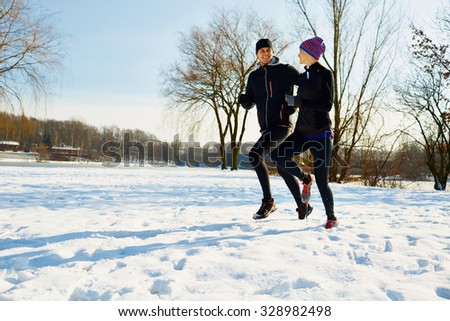 Couple of runners at winter in park