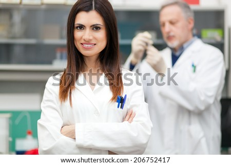 Couple of scientist researching in a laboratory