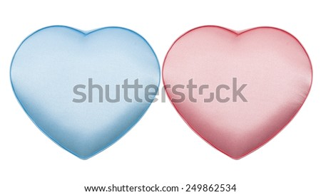 Couple of silk boxes in the form of heart, pink and blue, isolated on the white - stock photo