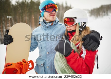 Couple of snowboarders on winter resort