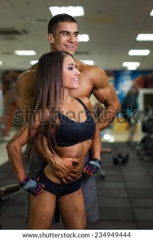 Couple of sportsmen - stock photo