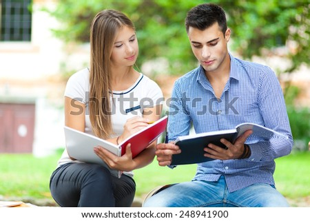 Couple of students talking together - stock photo