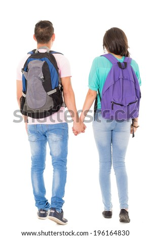 couple of students with backpack walking away on white background - stock photo