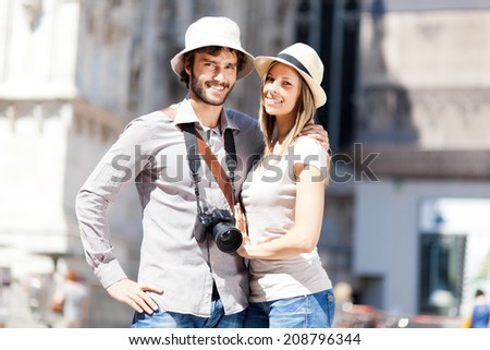 Couple of tourists in the city - stock photo