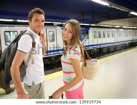 Couple of tourists waiting to get in train - stock photo