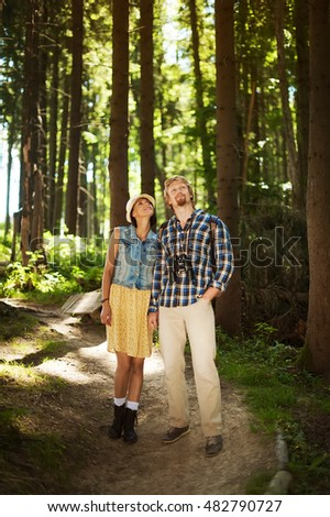 couple of woman and man dressed in country walking in the deep forest