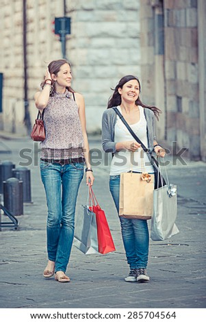 Couple of Women with Shopping Bags - stock photo