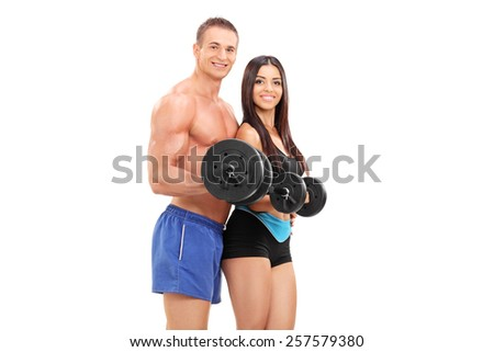 Couple of young athletes exercising with barbells isolated on white background - stock photo