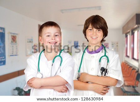 Couple of young doctors in the hospital - stock photo