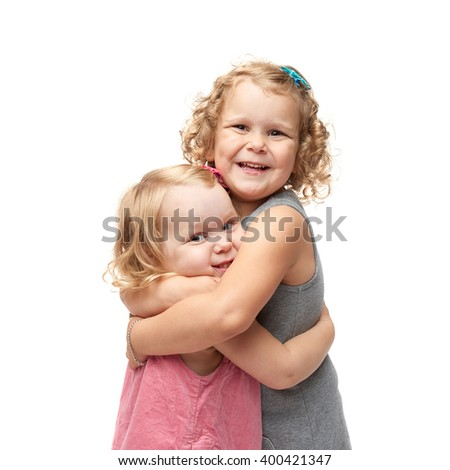 Couple of young little girls standing over isolated white background