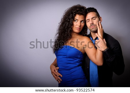 couple of young loves together showing affection - stock photo