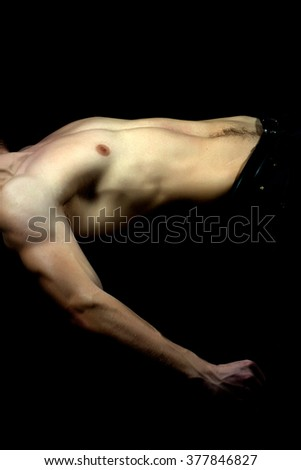 Couple of young muscular handsome man with strong half dressed sexy body with bare chest indoor on black background, vertical picture
