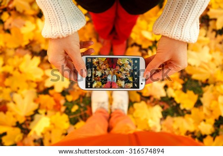 Couple of young people are taking a picture - stock photo