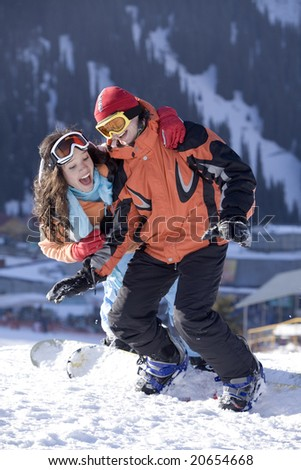 Couple of young snowboarders, Tien Shan - stock photo