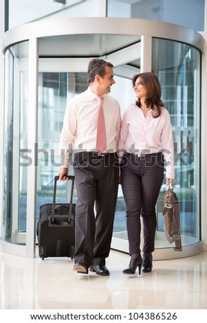 Couple on a business trip at the hotel lobby