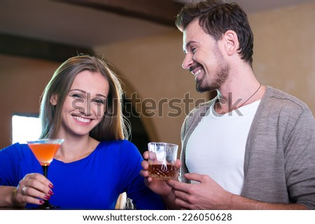 Couple on a date at the bar drinking alcohol