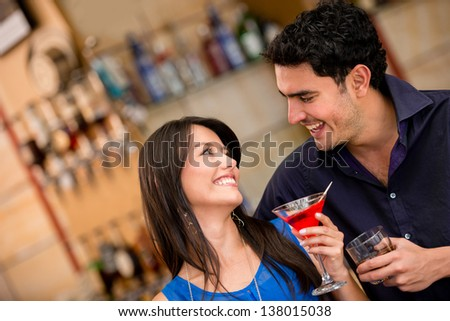 Couple on a date going out from drinks at the bar - stock photo