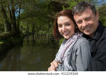 Couple on a the river visiting a city - tourism concept