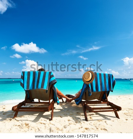 Couple on a tropical beach at maldives stock photo for Tropical vacations for couples