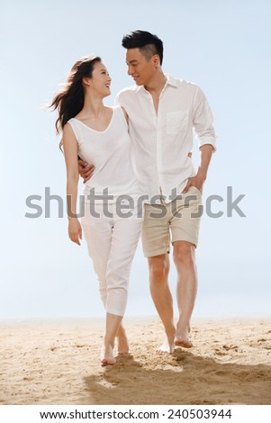 Couple on beach - stock photo