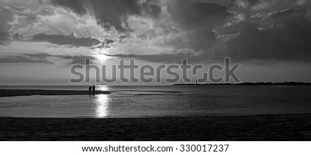 Couple on beach at sunset black and white