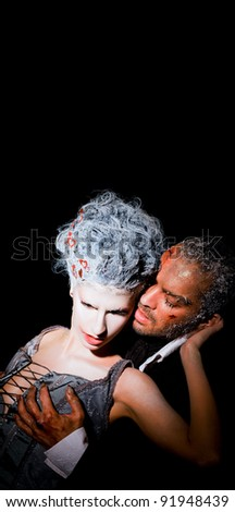 Couple on black background passionately touching each other, frost faces