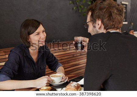 Couple on coffee date in a modern cafe - stock photo