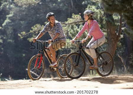 Couple on country bike ride - stock photo