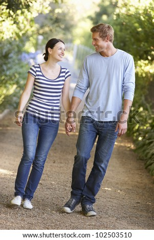 Couple on country walk - stock photo