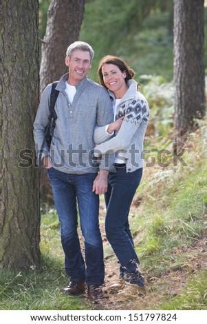 Couple On Country Walk Through Woodland - stock photo