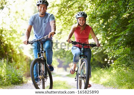 Couple On Cycle Ride In Countryside - stock photo