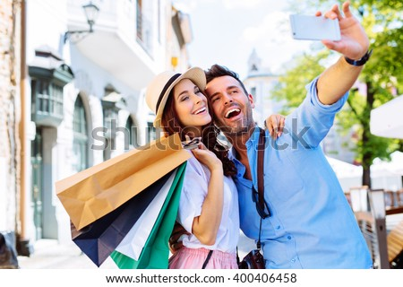 Couple on european vacation doing selfie in old city - stock photo