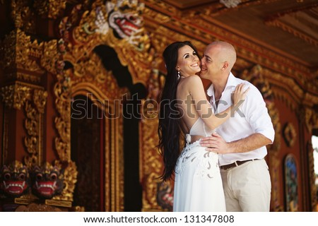 Couple on exotic wedding in hindu temple, bali, indonesia - stock photo
