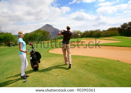 Couple on golf green