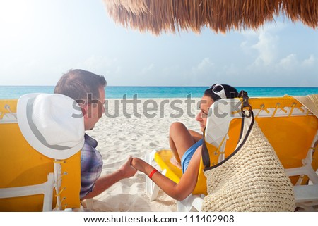 Couple on holidays at Caribbean Sea - stock photo