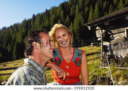 Couple on mountain pasture - stock photo