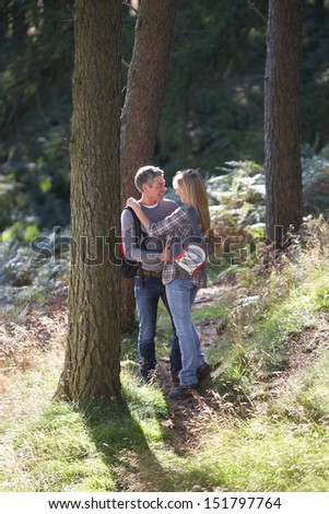 Couple On Romantic Country Walk Through Woodland - stock photo