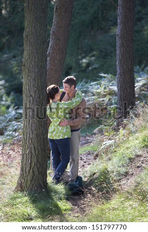 Couple On Romantic Country Walk Through Woodland