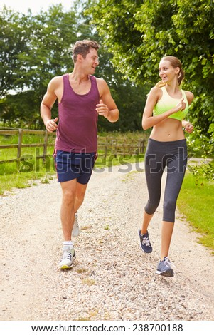 Couple On Run In Countryside Together - stock photo