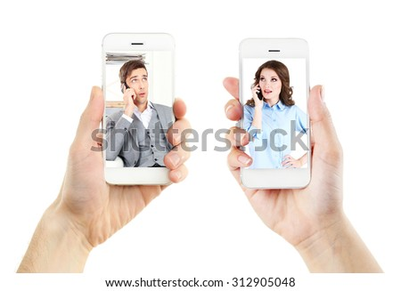 Couple on screens of phones. Online video call concept - stock photo