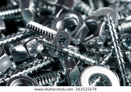 Couple on screws, bolts and nuts. Macro shot. Background. - stock photo