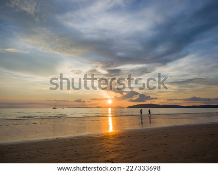 Couple on the beach at  Sunset in Krabi Thailand  - stock photo