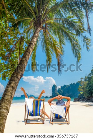 Couple on the beach at tropical resort in Thailand  Travel concept