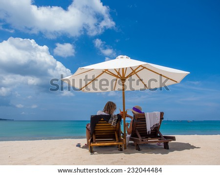 Couple on the beach in Bali Indonesia on their honeymoon