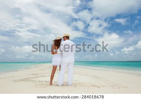 Couple on the beach of sea - stock photo