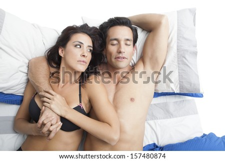 Couple on the bed  - stock photo