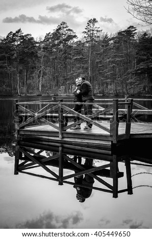 Couple on the bridge in monochrome