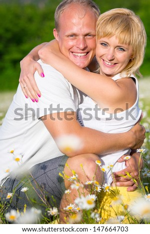 Couple on the camomile meadow