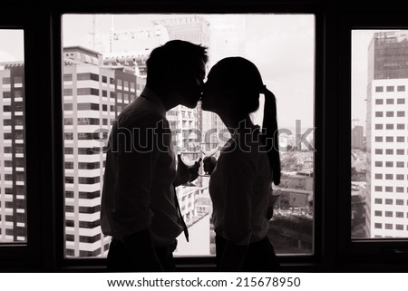 Couple on the romantic date with city background. - stock photo
